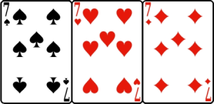 The sevens of spades, hearts, and diamonds.