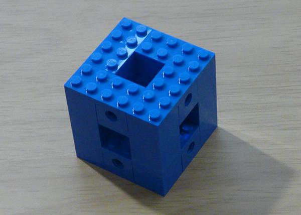 A complete Menger sponge module.
