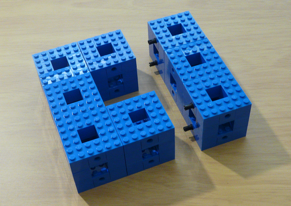 Joining modules with friction pegs.